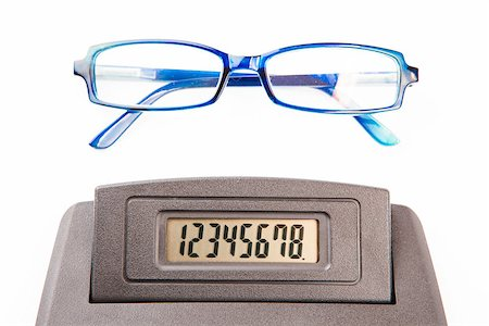 Glasses and sector of calculator with numbers at display Stock Photo - Budget Royalty-Free & Subscription, Code: 400-06864438