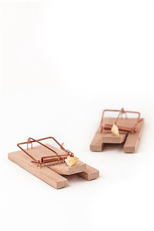 Two mousetraps with cheese on white background Stock Photo - Budget Royalty-Free & Subscription, Code: 400-06864447