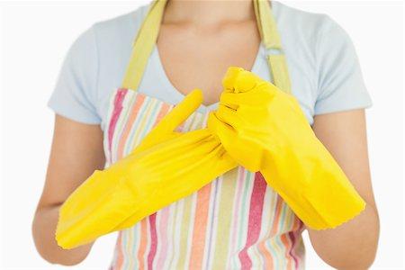 rubber apron woman - Woman taking off her rubber gloves in apron Stock Photo - Budget Royalty-Free & Subscription, Code: 400-06866387