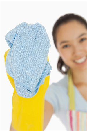 rubber apron woman - Laughing woman cleaning with cloth wearing rubber gloves and apron Stock Photo - Budget Royalty-Free & Subscription, Code: 400-06866424