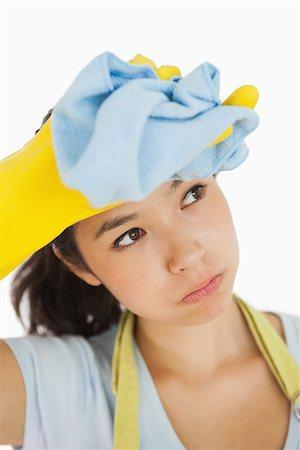 rubber apron woman - Woman wiping her brow wearing rubber gloves and an apron Stock Photo - Budget Royalty-Free & Subscription, Code: 400-06866422