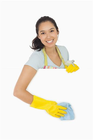 rubber apron woman - Smiling woman in rubber gloves and apron wiping down white surface Stock Photo - Budget Royalty-Free & Subscription, Code: 400-06866434