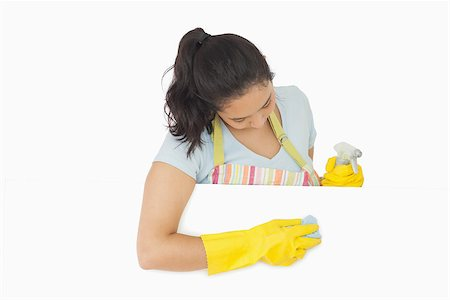 rubber apron woman - Woman in apron and rubber gloves wiping down white surface Stock Photo - Budget Royalty-Free & Subscription, Code: 400-06866431