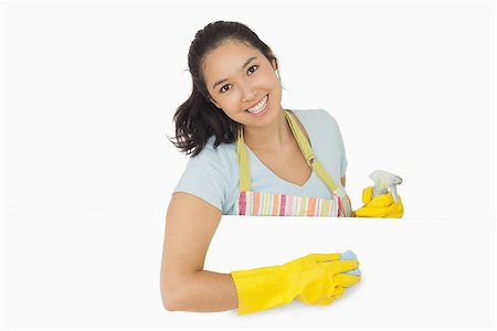 rubber apron woman - Happy woman in rubber gloves and apron wiping white surface Stock Photo - Budget Royalty-Free & Subscription, Code: 400-06866432