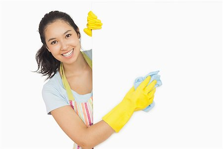 rubber apron woman - Cheerful woman cleaning white surface in apron and rubber gloves Stock Photo - Budget Royalty-Free & Subscription, Code: 400-06866440