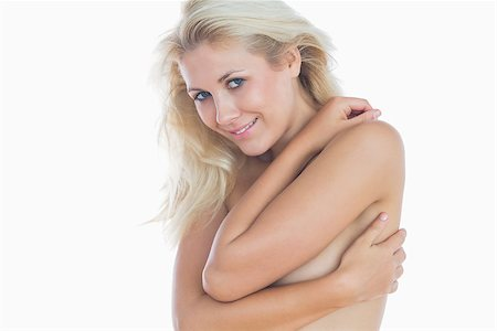 Portrait of happy sensuous woman hugging herself over white background Stock Photo - Budget Royalty-Free & Subscription, Code: 400-06869818