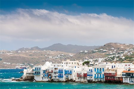 White houses of island Mykonos from the mountains to the sea in sunny weather Stock Photo - Budget Royalty-Free & Subscription, Code: 400-06861459