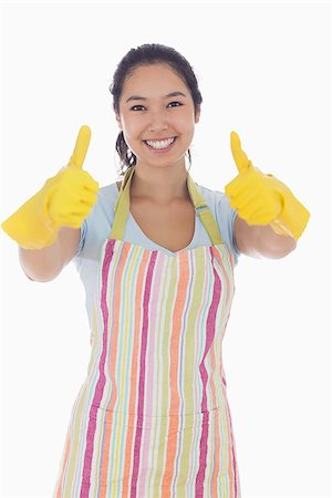 rubber apron woman - Happy woman giving thumbs up in rubber gloves and apron Stock Photo - Budget Royalty-Free & Subscription, Code: 400-06863554