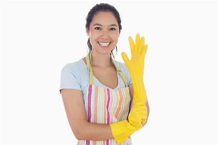 rubber apron woman - Smiling woman in apron pulling on rubber glove Stock Photo - Budget Royalty-Free & Subscription, Code: 400-06863557