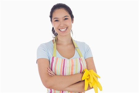 rubber apron woman - Standing woman smiling and wearing apron while holding rubber gloves Stock Photo - Budget Royalty-Free & Subscription, Code: 400-06863558