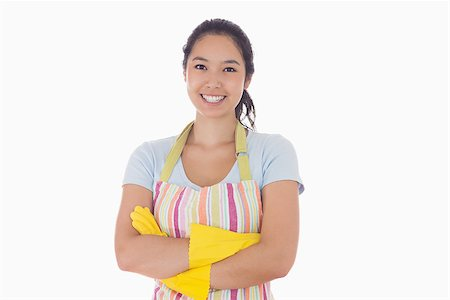 rubber apron woman - Smiling woman standing with arms crossed wearing apron and rubber gloves Stock Photo - Budget Royalty-Free & Subscription, Code: 400-06863551