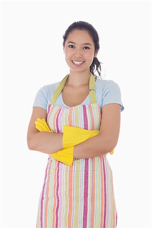 rubber apron woman - Smiling woman standing with crossed arms and wearing apron and rubber gloves Stock Photo - Budget Royalty-Free & Subscription, Code: 400-06863552