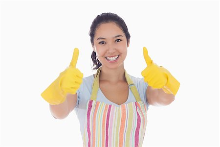 rubber apron woman - Smiling woman in rubber gloves and apron giving thumbs up Stock Photo - Budget Royalty-Free & Subscription, Code: 400-06863553