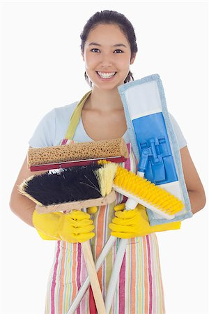 rubber apron woman - Woman in apron and rubber gloves holding mops and brushes Stock Photo - Budget Royalty-Free & Subscription, Code: 400-06863564