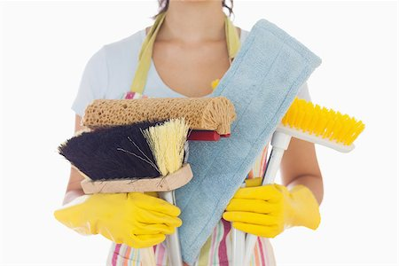 rubber apron woman - Woman in apron and rubber gloves holding brushes and mops Stock Photo - Budget Royalty-Free & Subscription, Code: 400-06863566