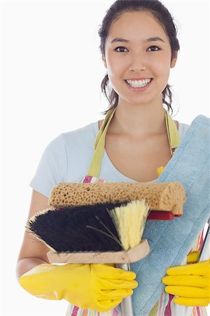 rubber apron woman - Smiling woman holding brushes and mops wearing apron and rubber gloves Stock Photo - Budget Royalty-Free & Subscription, Code: 400-06863567