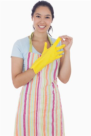 rubber apron woman - Smiling woman in apron taking off rubber gloves Stock Photo - Budget Royalty-Free & Subscription, Code: 400-06863561