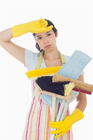 rubber apron woman - Tired woman in apron and rubber gloves holding cleaning tools Stock Photo - Budget Royalty-Free & Subscription, Code: 400-06863586