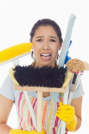 rubber apron woman - Distressed young woman in apron and rubber gloves holding cleaning tools Stock Photo - Budget Royalty-Free & Subscription, Code: 400-06863588