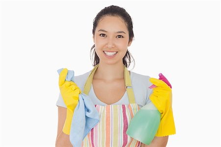 rubber apron woman - Smiling woman holding cloth and spray bottle in apron and rubber gloves Stock Photo - Budget Royalty-Free & Subscription, Code: 400-06863589