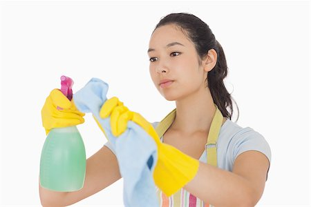 rubber apron woman - Woman wiping surface with cloth wearing apron and rubber gloves Stock Photo - Budget Royalty-Free & Subscription, Code: 400-06863594