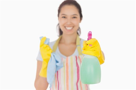 rubber apron woman - Smiling woman in apron and rubber gloves holding up spray bottle Stock Photo - Budget Royalty-Free & Subscription, Code: 400-06863590