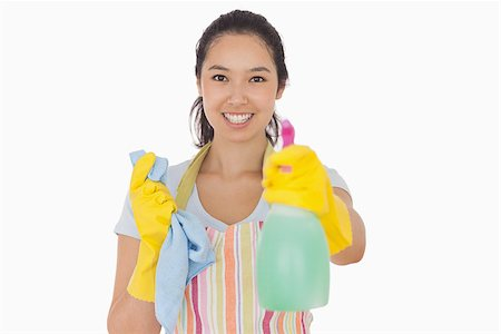 rubber apron woman - Cheerful woman holding up spray bottle in rubber gloves and apron Stock Photo - Budget Royalty-Free & Subscription, Code: 400-06863591