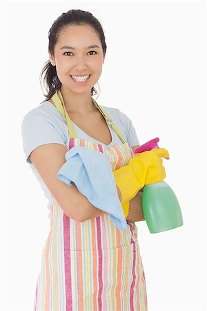 rubber apron woman - Happy woman holding spray bottle and rag in apron and rubber gloves Stock Photo - Budget Royalty-Free & Subscription, Code: 400-06863608