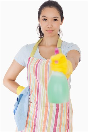 rubber apron woman - Smiling woman spraying cleaner in apron and rubber gloves Stock Photo - Budget Royalty-Free & Subscription, Code: 400-06863614
