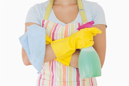 rubber apron woman - Woman holding window cleaner and rag wearing apron and rubber gloves Stock Photo - Budget Royalty-Free & Subscription, Code: 400-06863610