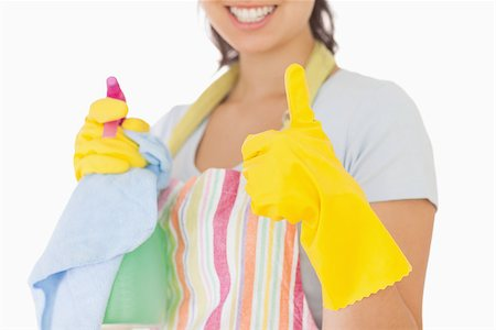 rubber apron woman - Woman giving thumbs up in rubber gloves holding cleaning products Stock Photo - Budget Royalty-Free & Subscription, Code: 400-06863626