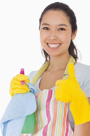 rubber apron woman - Smiling woman with cleaning products giving thumbs up in rubber gloves Stock Photo - Budget Royalty-Free & Subscription, Code: 400-06863628