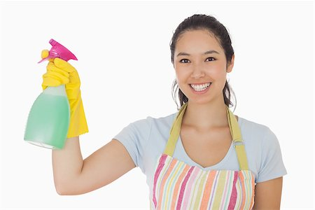 rubber apron woman - Young woman holding a window cleaner and smiling in apron and rubber gloves Stock Photo - Budget Royalty-Free & Subscription, Code: 400-06863620