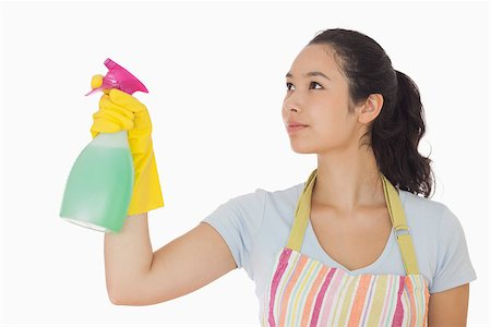 rubber apron woman - Young woman spraying cleaner in rubber gloves and apron Stock Photo - Budget Royalty-Free & Subscription, Code: 400-06863621