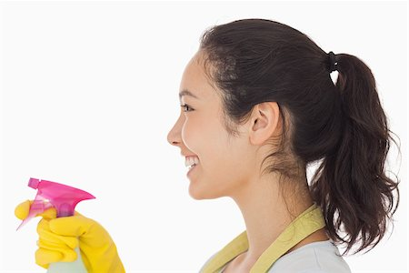 rubber apron woman - Cheerful woman using a window cleaner wearing rubber gloves Stock Photo - Budget Royalty-Free & Subscription, Code: 400-06863623