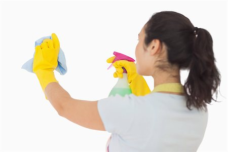 rubber apron woman - Brunetter woman spraying and wiping in rubber gloves Stock Photo - Budget Royalty-Free & Subscription, Code: 400-06863637