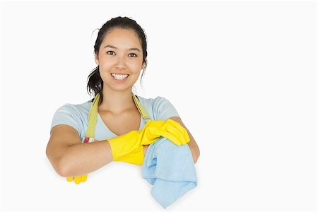 rubber apron woman - Smiling woman in apron and rubber gloves leaning on white surface with a rag Stock Photo - Budget Royalty-Free & Subscription, Code: 400-06863655