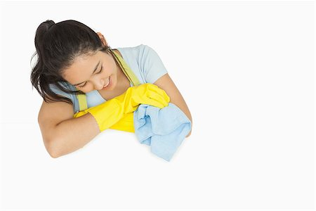 rubber apron woman - Smiling woman in rubber gloves and apron looking at white surface holding rag Stock Photo - Budget Royalty-Free & Subscription, Code: 400-06863656