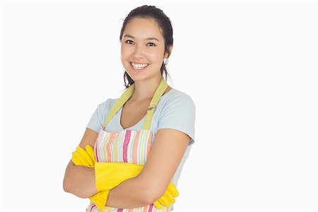 rubber apron woman - Smiling young woman with crossed arms wearing apron and rubber gloves Stock Photo - Budget Royalty-Free & Subscription, Code: 400-06863686