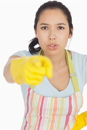 rubber apron woman - Accusing woman in apron and rubber gloves pointing ahead Stock Photo - Budget Royalty-Free & Subscription, Code: 400-06863687