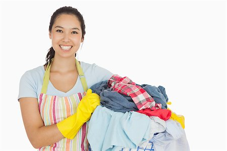 rubber apron woman - Laughing woman holding laundry basket wearing apron and rubber gloves Stock Photo - Budget Royalty-Free & Subscription, Code: 400-06863692