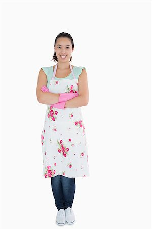 rubber apron woman - Smiling woman wearing apron and rubber gloves Stock Photo - Budget Royalty-Free & Subscription, Code: 400-06863895