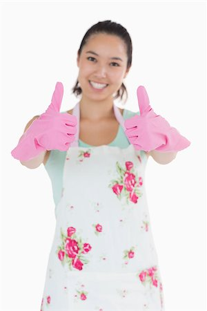 rubber apron woman - Happy woman in apron and rubbre gloves giving thumbs up Stock Photo - Budget Royalty-Free & Subscription, Code: 400-06863892