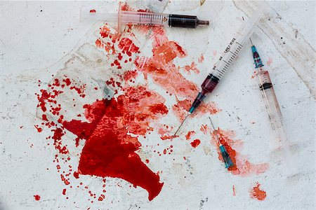 Three syringes lying on blood splatter on the floor Stock Photo - Budget Royalty-Free & Subscription, Code: 400-06876267