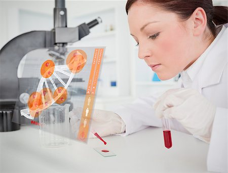 Scientist pouring drop of blood onto glass with futuristic interface in front of her Stock Photo - Budget Royalty-Free & Subscription, Code: 400-06877722