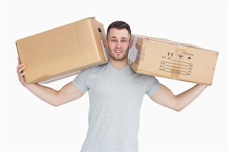 Portrait of tired young man carrying package boxes over white background Stock Photo - Budget Royalty-Free & Subscription, Code: 400-06870401