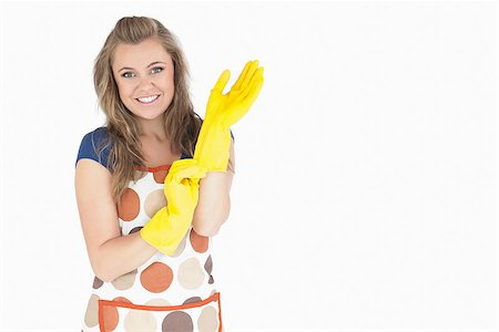 rubber apron woman - Portrait of smiling young maid with rubber gloves over white background Stock Photo - Budget Royalty-Free & Subscription, Code: 400-06870597