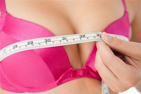 Extreme closeup of woman measuring chest in pink bra Stock Photo - Budget Royalty-Free & Subscription, Code: 400-06870708