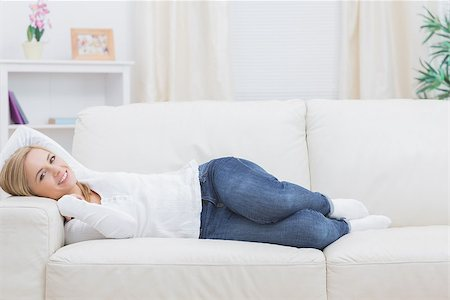 Portrait of casual young woman lying on sofa at home Stock Photo - Budget Royalty-Free & Subscription, Code: 400-06872339