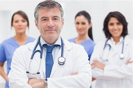 Doctor and his team smiling at camera Stock Photo - Budget Royalty-Free & Subscription, Code: 400-06873855